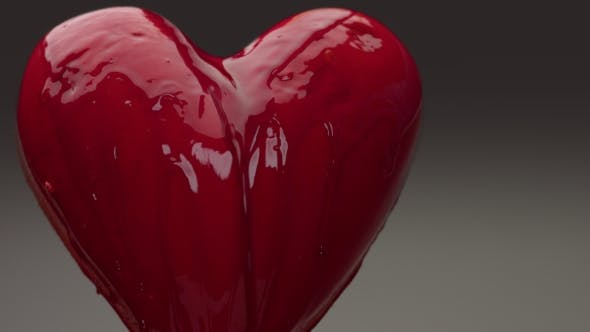 Thumbnail for Flying Red Wet Heart in Air with Red Transparent Liquid Covered It and Pouring on It