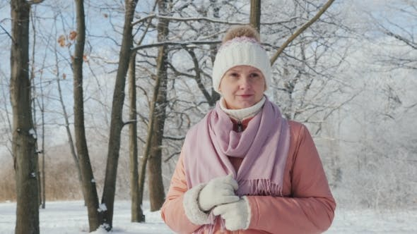 Thumbnail for Happy Young Woman Is Walking in the Winter Forest. A Beautiful Clear Day, the Branches of Trees Are