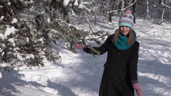 Thumbnail for Girl Having Fun with Snow Tree
