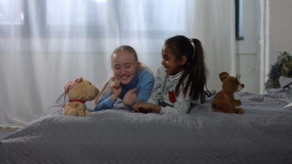 Thumbnail for Joyful Multiracial Kids Having Fun on the Bed