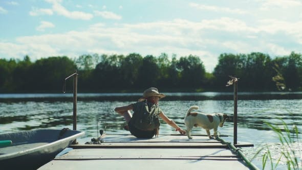 Thumbnail for Boy On A Pier With Dog
