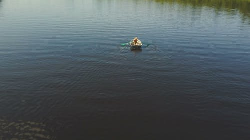 Tourist Rowing A Boat