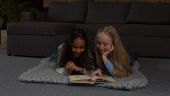 Thumbnail for Happy Multiracial Kids Reading Fairytales at Home