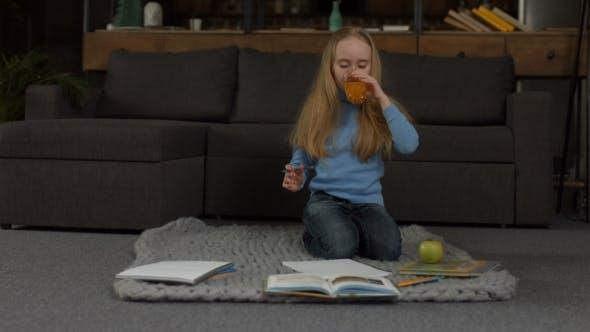 Thumbnail for Elementary School Girl Writing Her Homework