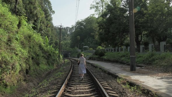 Thumbnail for Young Girl Walks on the Railway