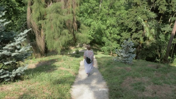 Thumbnail for Young Girl Walking in Tropical Botanical Garden. Batumi