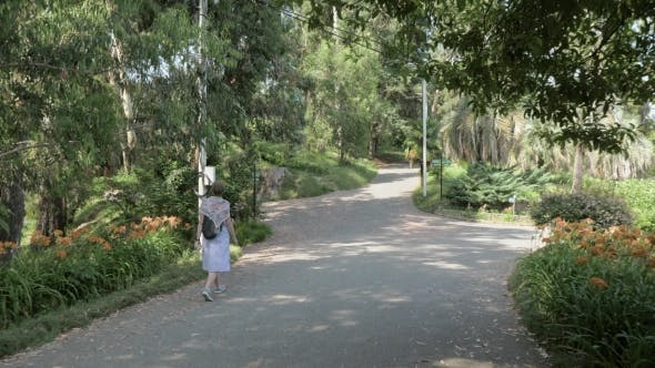 Thumbnail for Young Girl Walking in Tropical Botanical Garden. Batumi, Georgia