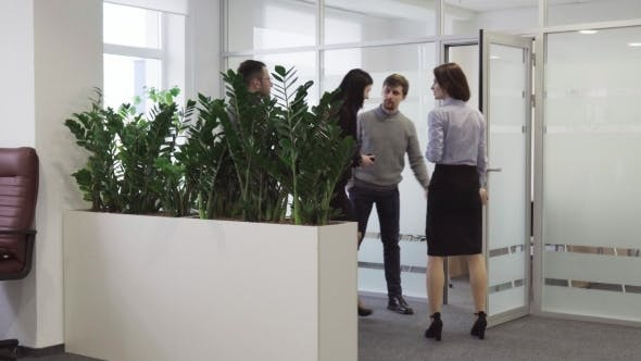 Thumbnail for Businessman Invites a Team of Business People To Enter Meeting Room at Office