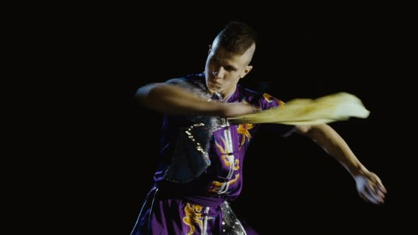 Thumbnail for Young Man Training Wushu with Sword