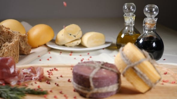 Restaurant Concept. Table Setting. Two Pieces of Cheeese Decorated with Rope Are on Wooden