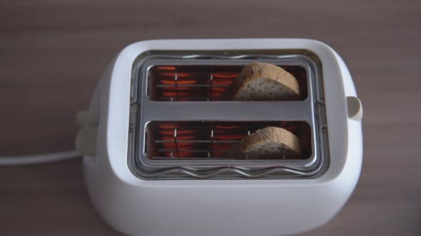 Toaster with Bread on the Table