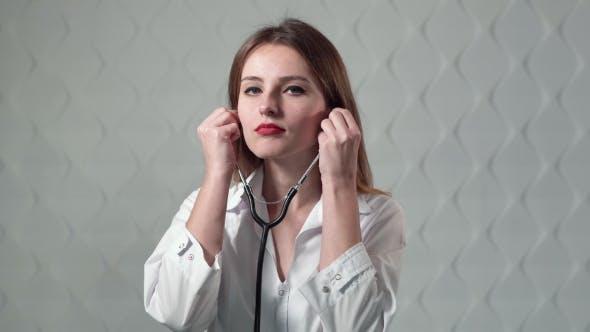 Medical Practitioner Uses Stethoscope