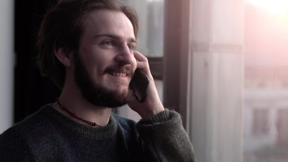 Thumbnail for Man Talks on Phone