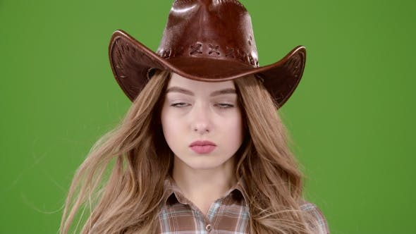 Cover Image for Girl Is Posing for Cameras in the Cowboy Look. Green Screen.