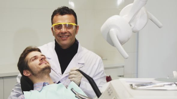 Thumbnail for Professionl Mature Male Dentist Performing Dental Examination