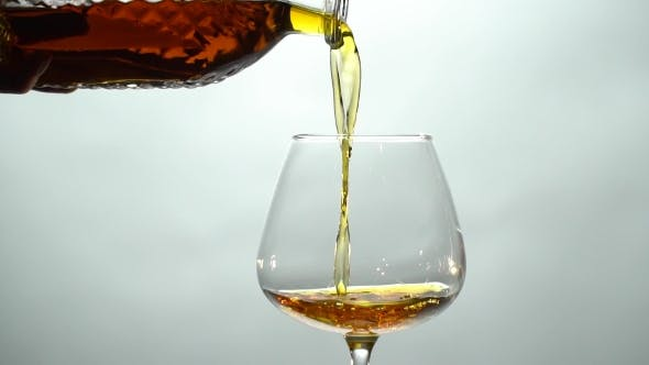 Thumbnail for Pouring Cognac from a Decanter into a Glass