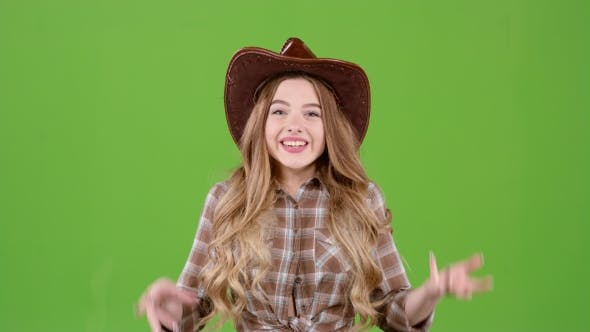Thumbnail for Girl in the Cowboy Hat Rejoices at the Victory. Green Screen