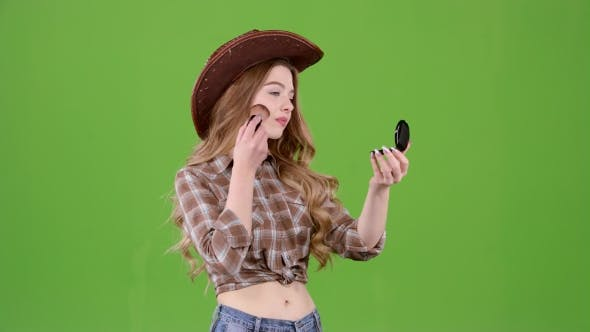 Thumbnail for Cowboy Girl Is Holding a Brush and Powdering Her Face. Green Screen