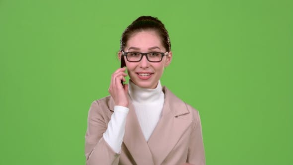 Thumbnail for Business Girl Speaks on the Phone, Tells His Girlfriend Important News. Green Screen