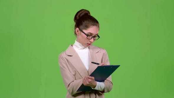 Thumbnail for Manager Fills the Questionnaire with a Pen on a Paper Tablet. Green Screen