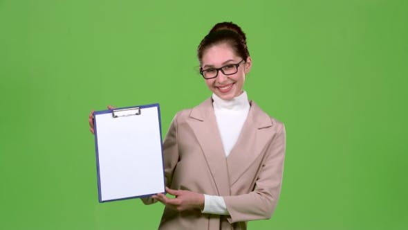 Thumbnail for Girl Advertising Agent Shows Important Information on the Tablet. Green Screen