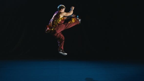 Thumbnail for Young Man Training Wushu Against Black Background