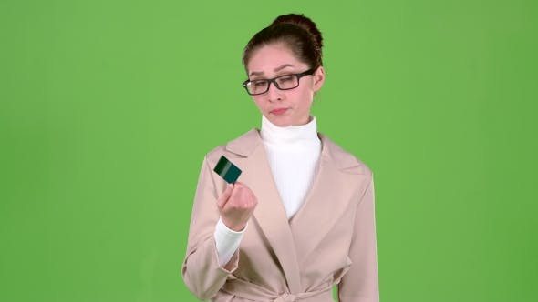 Thumbnail for Business Lady Holding a Credit Card in Her Hands Has No Money. Green Screen