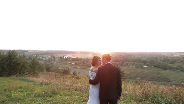 Thumbnail for Young Bride and Groom at Sunset