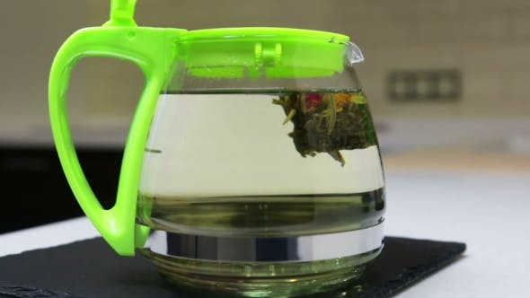 Thumbnail for Brewing Flower Tea in the Kitchen in a Glass Teapot