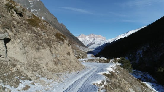 Thumbnail for Flight Over Snowy Mountain Road in the Wild