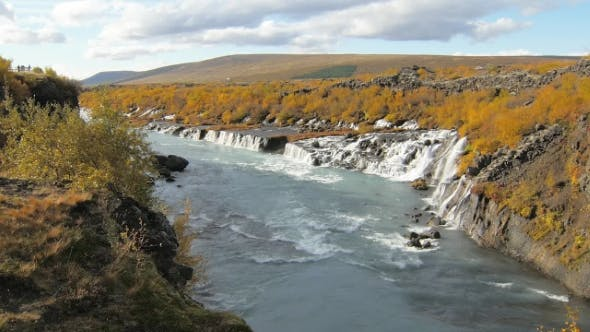 Thumbnail for Valley with Famous and Picturesque Waterfalls Hraunfossar in Iceland in Sunny Autumn Weather