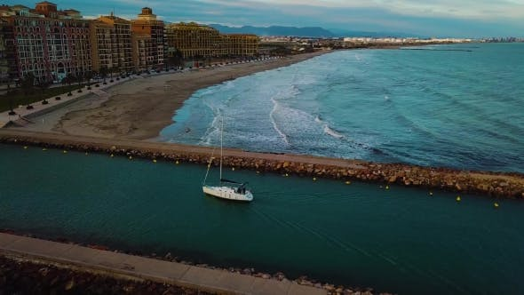 Cover Image for View From Above on Small Yacht During Sunset on Mediterranean Sea Coast Near Valencia