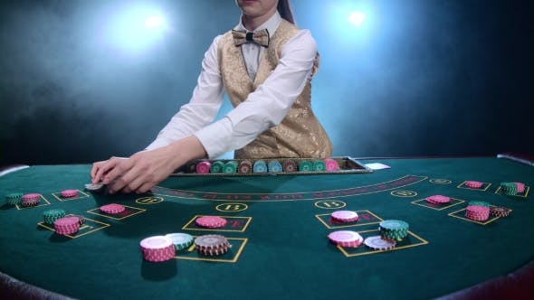 Thumbnail for Casino Croupier Girl Shuffles the Poker Cards and Performing Trick with Cards. Smoke.