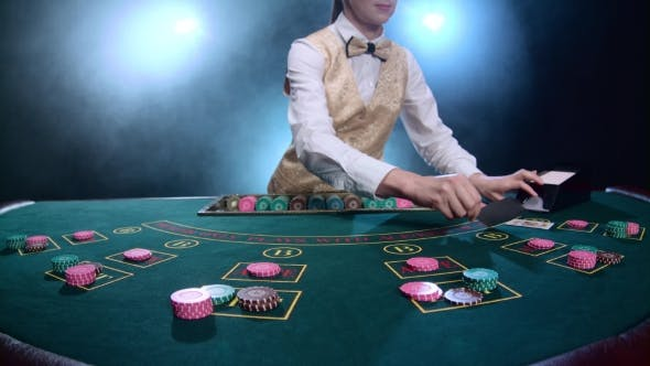 Thumbnail for Croupier Placing Cards for Poker on the Table in Casino. Smoke.