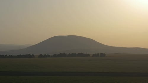 Hill in the Setting Sun