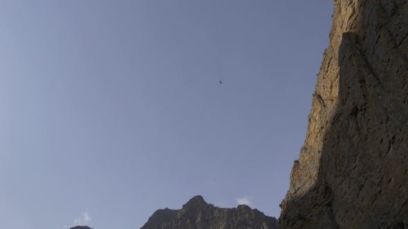 Thumbnail for Hanging on a Rope After a Jump Next To a Huge Rock