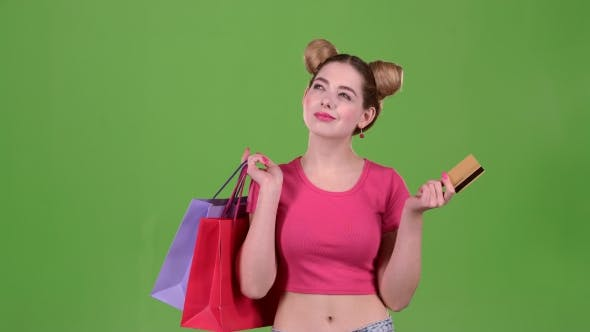 Thumbnail for Teen Holds Shopping Bags and a Gold Credit Card. Green Screen