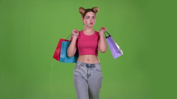 Thumbnail for Teenager Goes Shopping with Bags in His Hands