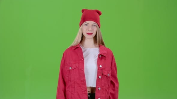 Thumbnail for Teen Advertises the Goods and Shows a Finger Down on Green Screen