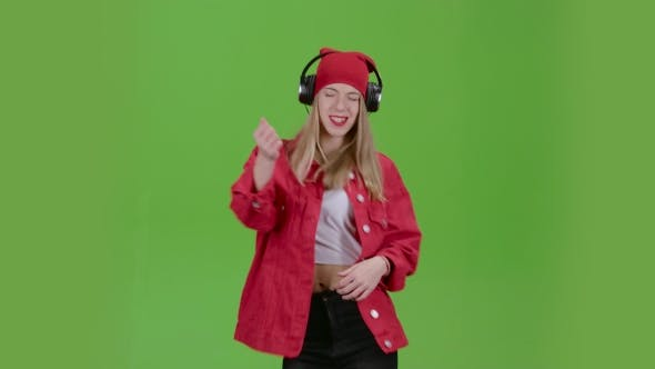 Thumbnail for Girl Listens To Music on Headphones with Energetic Songs