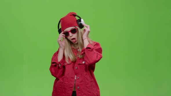 Thumbnail for Girl Listens To Music on Headphones with Energetic Songs. Green Screen