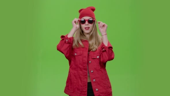 Thumbnail for Teen in Stylish Clothes and Red Glasses Dances and Gives Out Different Emotions