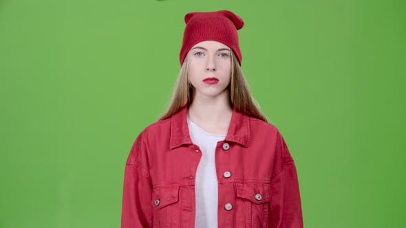 Thumbnail for Teen Raises a Blue Card and Points at It, Recommends. Green Screen