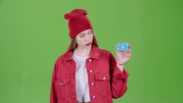 Thumbnail for Girl Raises a Blue Card and Shows a Thumbs Up and Shows Ok. Green Screen
