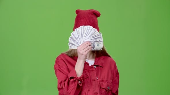 Thumbnail for Girl Is Holding Paper Money in Her Hands