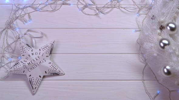 Thumbnail for Mockup On a Wooden White Table Is a Garland and New Year's Toys. Top View