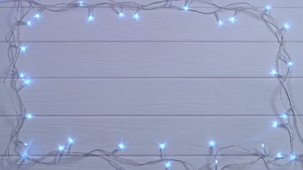 Thumbnail for Mockup Snow White Christmas Garland Burns with Bright Colors. Top View
