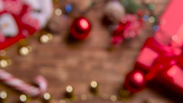 Thumbnail for Different New Year's Toys Sweets and Flowers Lie on the Table. Top View