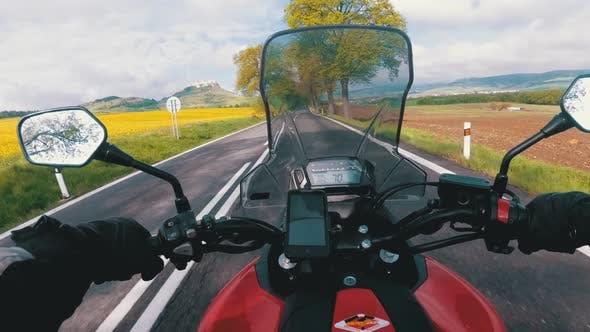Thumbnail for Motorcyclist Riding on the Road Near Spiss Castle. Spissky Hrad. Slovakia