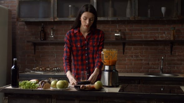 Thumbnail for Woman Pouring Some Fresh Homemade Juice Into Glass